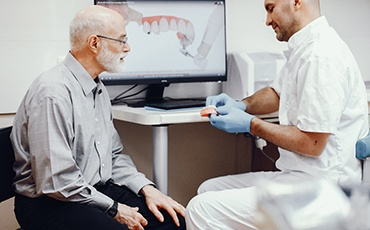 A dentist explaining All-on-4 treatment in Jacksonville.