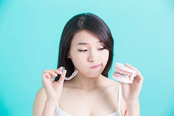 Woman considering Invisalign and orthodontics