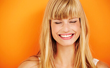 Jacksonville Cosmetic Dentist Woman with blonde hair smiling