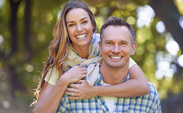 Jacksonville Restorative Dentistry Couple outdoors smiling