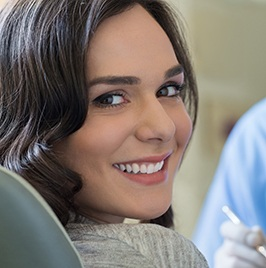 Woman with dark hair smiling in exam room