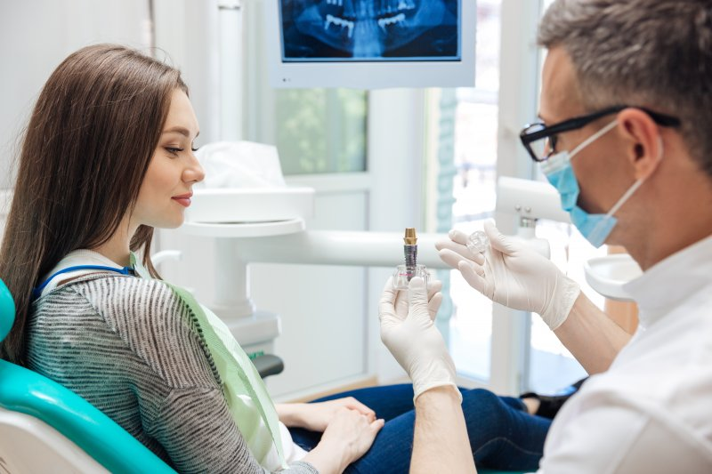 Dentist talking to patient about dental implants